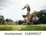 young man and woman doing yoga...