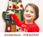 portrait of a smiling little... | Shutterstock . vector #518162923