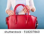 woman putting pills to red... | Shutterstock . vector #518207863