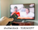 holding tv remote control with... | Shutterstock . vector #518263297
