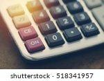 calculator on wood table focus...   Shutterstock . vector #518341957