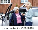 female neighbor giving senior... | Shutterstock . vector #518378137