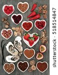 Small photo of Aphrodisiac food selection with foods in porcelain heart shaped bowls and loose on marble background.
