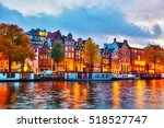 Stock photo amsterdam city view with amstel river at sunset 518527747