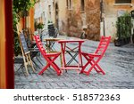 cozy outdoor cafe in rome ... | Shutterstock . vector #518572363