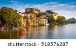 city palace and pichola lake in ... | Shutterstock . vector #518576287