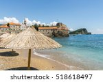 Straw Umbrellas On Budva Old...