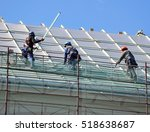 roofers work on the roof | Shutterstock . vector #518638687