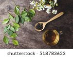 cup of tea and leaves and dried ... | Shutterstock . vector #518783623