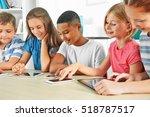 schoolchildren sitting in... | Shutterstock . vector #518787517