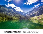 stunning pond in the mountains... | Shutterstock . vector #518870617