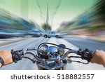A Man Riding A Motorcycle ...