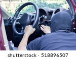 thieves trying to steal car. | Shutterstock . vector #518896507
