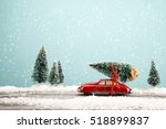 red car carrying a christmas... | Shutterstock . vector #518899837