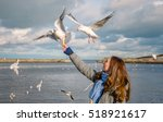Woman Feeds Birds On The...