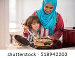 arabic young woman with little... | Shutterstock . vector #518942203