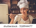 beautiful young woman in chef... | Shutterstock . vector #518944477