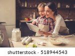beautiful young mom and her... | Shutterstock . vector #518944543