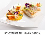Small photo of Fine dining, fish fillet breaded in herbs and spice on vegetable