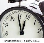 vintage alarm clock is showing... | Shutterstock . vector #518974513