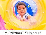 kids playing in playground | Shutterstock . vector #518977117