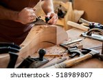 carpenter works with a planer... | Shutterstock . vector #518989807