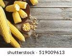sweet corns on a grey wooden...   Shutterstock . vector #519009613
