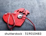 red puzzle heart with... | Shutterstock . vector #519010483