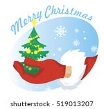 hand santa with christmas tree... | Shutterstock .eps vector #519013207