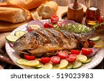 Grilled fish with baguette and...