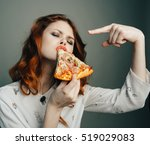satisfied and happy girl eating ... | Shutterstock . vector #519029083