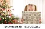 little girl holding christmas... | Shutterstock . vector #519036367