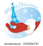 hand santa with eiffel tower on ... | Shutterstock .eps vector #519056737
