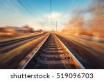 railroad in motion at sunset.... | Shutterstock . vector #519096703
