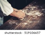 professional chef kneads the... | Shutterstock . vector #519106657