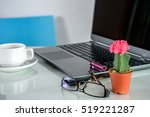 Small photo of Cactus pots, laptop & coffee cup at home office / Interior landscape plants decoration for air pollution abatement concept