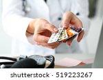 female doctor hand holding pack ... | Shutterstock . vector #519223267
