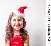 girl in santa hat headband | Shutterstock . vector #519335143