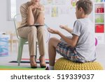 child sitting on a pouf ... | Shutterstock . vector #519339037