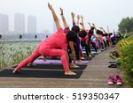 woman doing yoga exercise in... | Shutterstock . vector #519350347