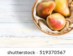 pears on a wooden background   Shutterstock . vector #519370567