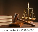 Gavel With Books And Scales On...