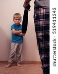 Small photo of Angry boy and abusive mother with belt. Child abuse. Domestic violence, aggression in the family.