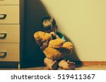 lonely scared boy sitting in... | Shutterstock . vector #519411367