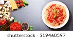 plate of pasta with tomato... | Shutterstock . vector #519460597