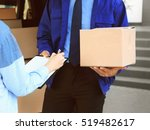 Woman Receiving Parcel From...