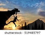 alpinist submits helping hand... | Shutterstock . vector #519485797