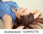 beautiful girl relaxing on floor | Shutterstock . vector #519491773