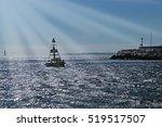 Black Buoy In The Sea In The Sun