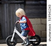 Small photo of Superhero Baby Boy Ride Bicycle Adorable Concept